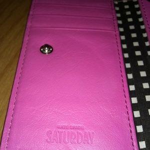 Kate Spade snap closure cell phone card holder.